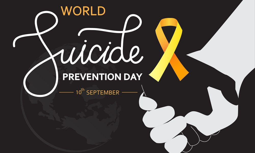 World Suicide Prevention Day concept with awareness ribbon. Dark